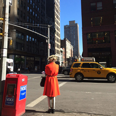 experience new york-A women in orange, New York