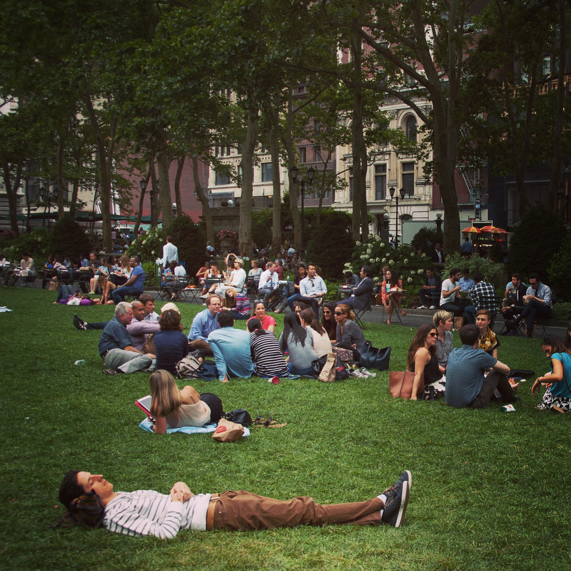 experience new york, bryant park . man having a nap